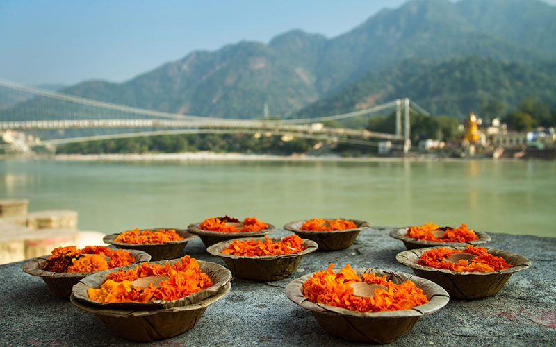 Puja flowers offering at the bank of Ganges river in Rishikesh, India